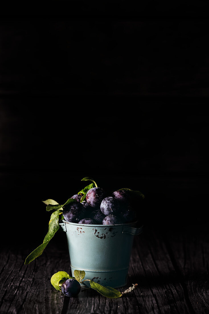 Plums in a small bucket