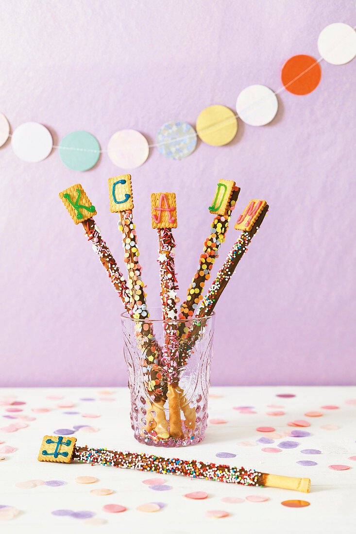 Breadsticks coated with chocolate and sprinkles
