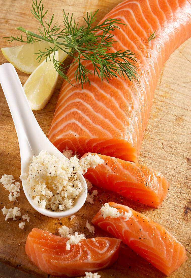 Smoked salmon fillet on a wooden board with horseradish