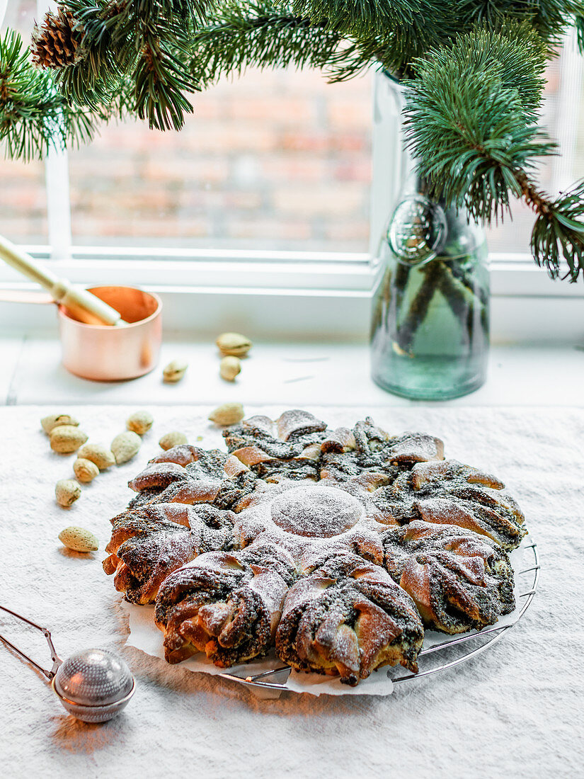 Star bread with poppy seeds and almonds