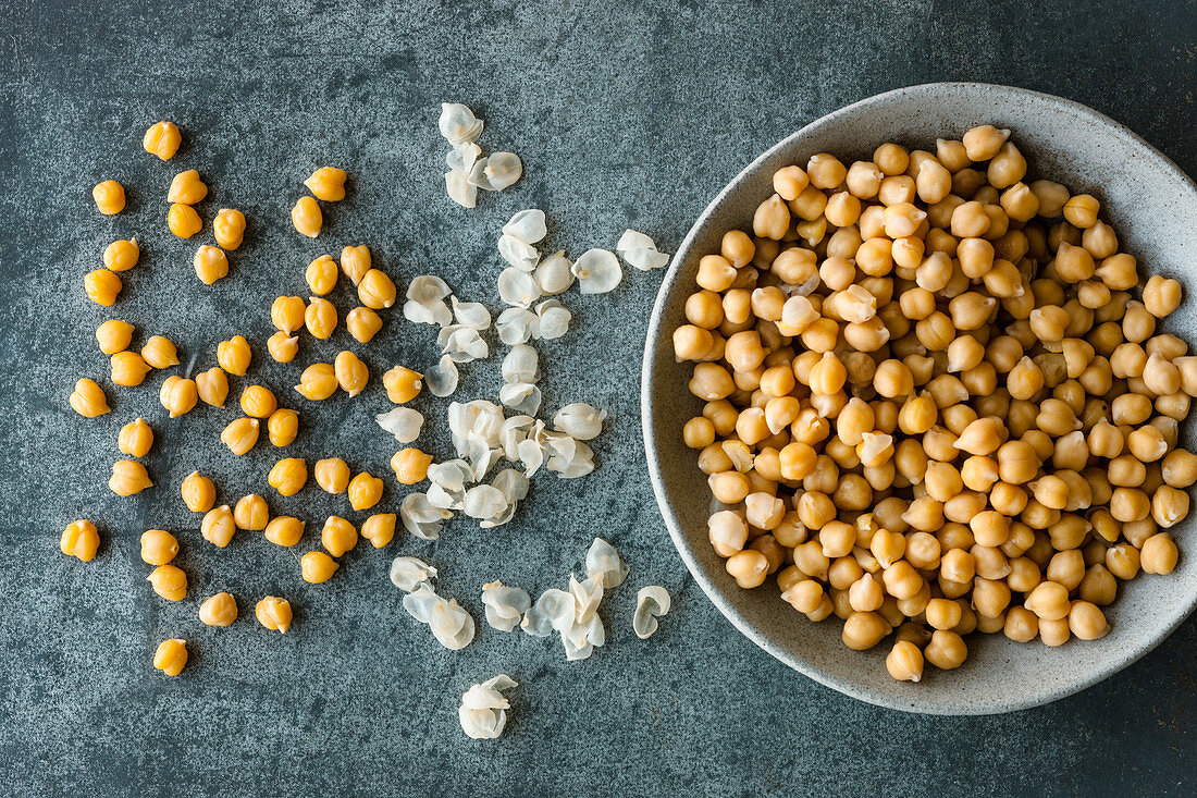 Freshly cooked chickpeas being shelled