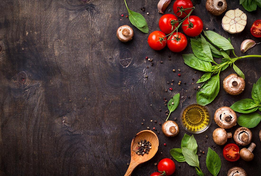 Mushrooms, vegetables, herbs, spices, olive oil on table