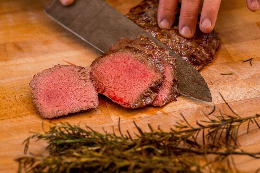 Sliced beef tenderloin with rosemary (medium rare)