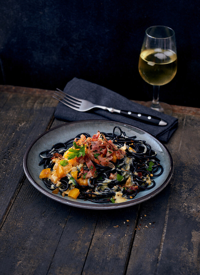 Black linguine with bacon and yellow peppers