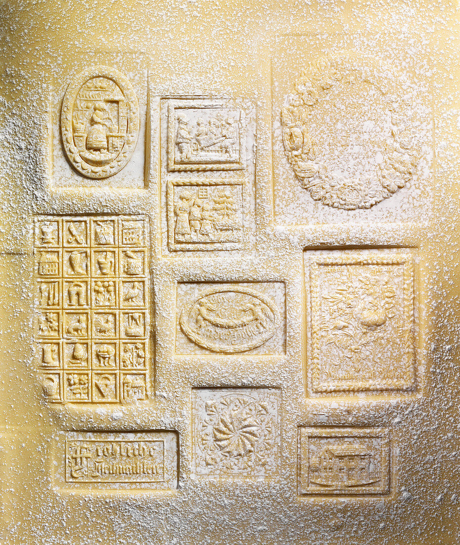 Springerle cookie dough stamped by group of stamps dusted with flour