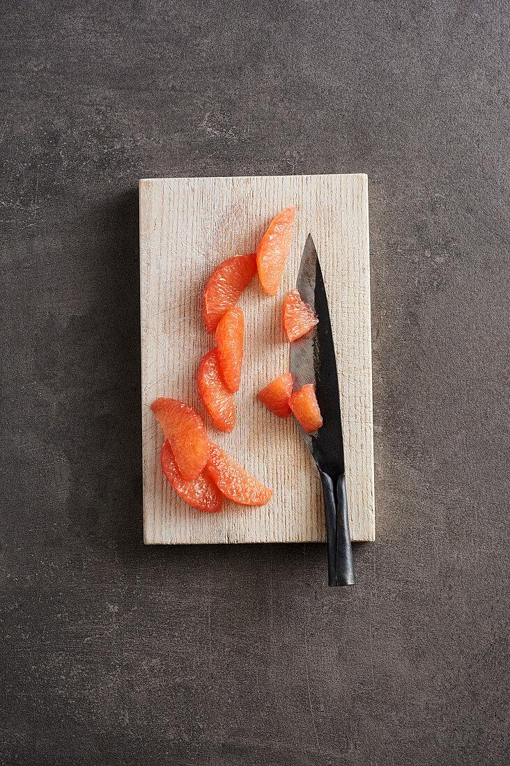 Grapefruit fillets being sliced