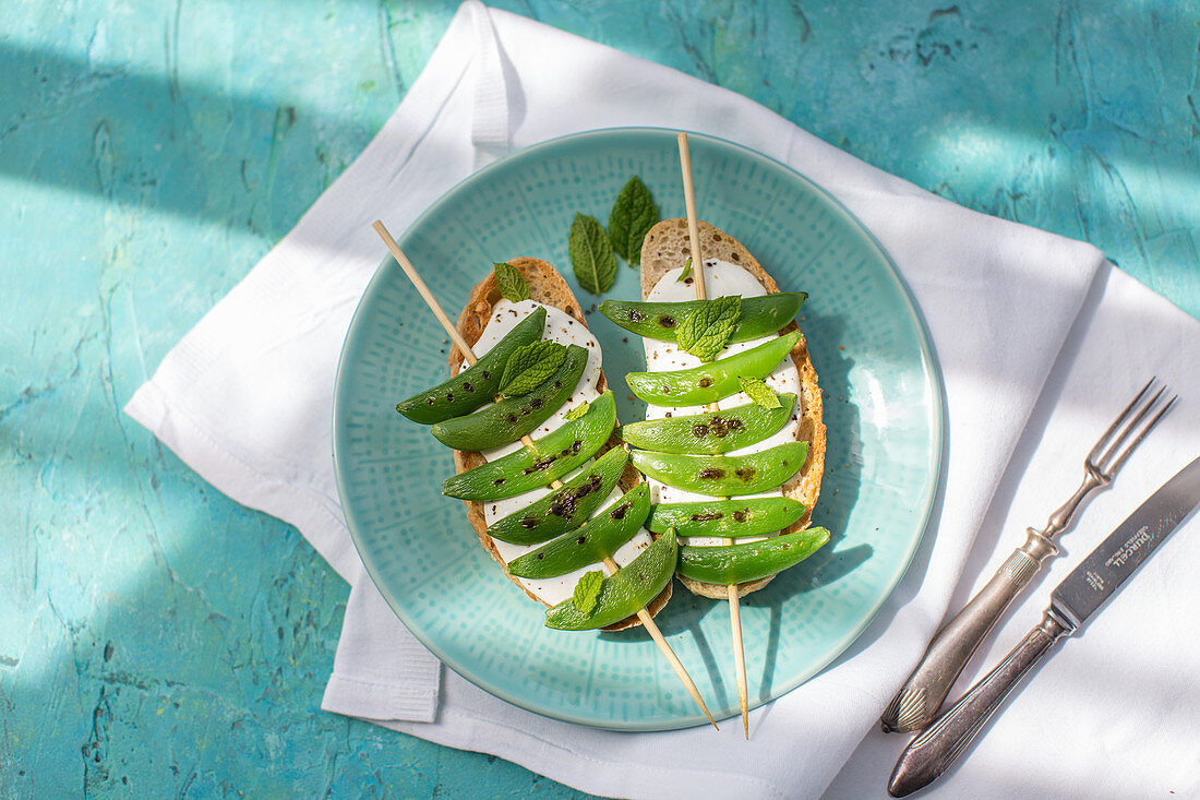 Soda bread with mint, ricotta cheese and grilled snap peas