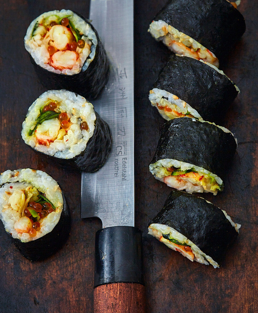 Maki sushi with seafood and caviar