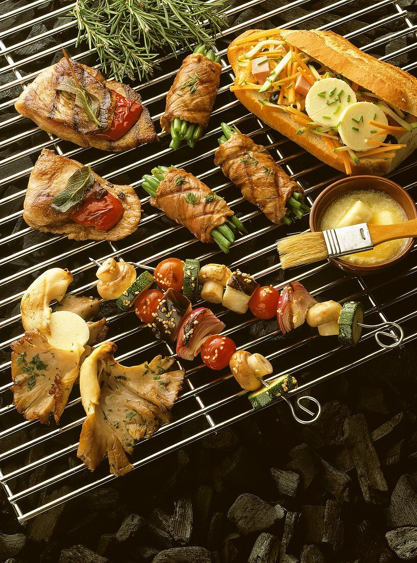Grill with meat, baguette, vegetable kebab, oyster mushrooms