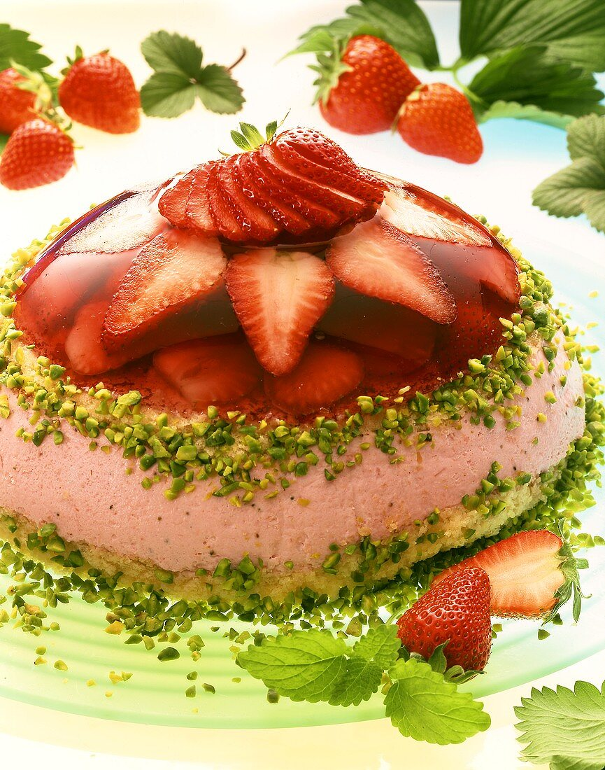 Two layer domed strawberry gateau with chopped pistachios