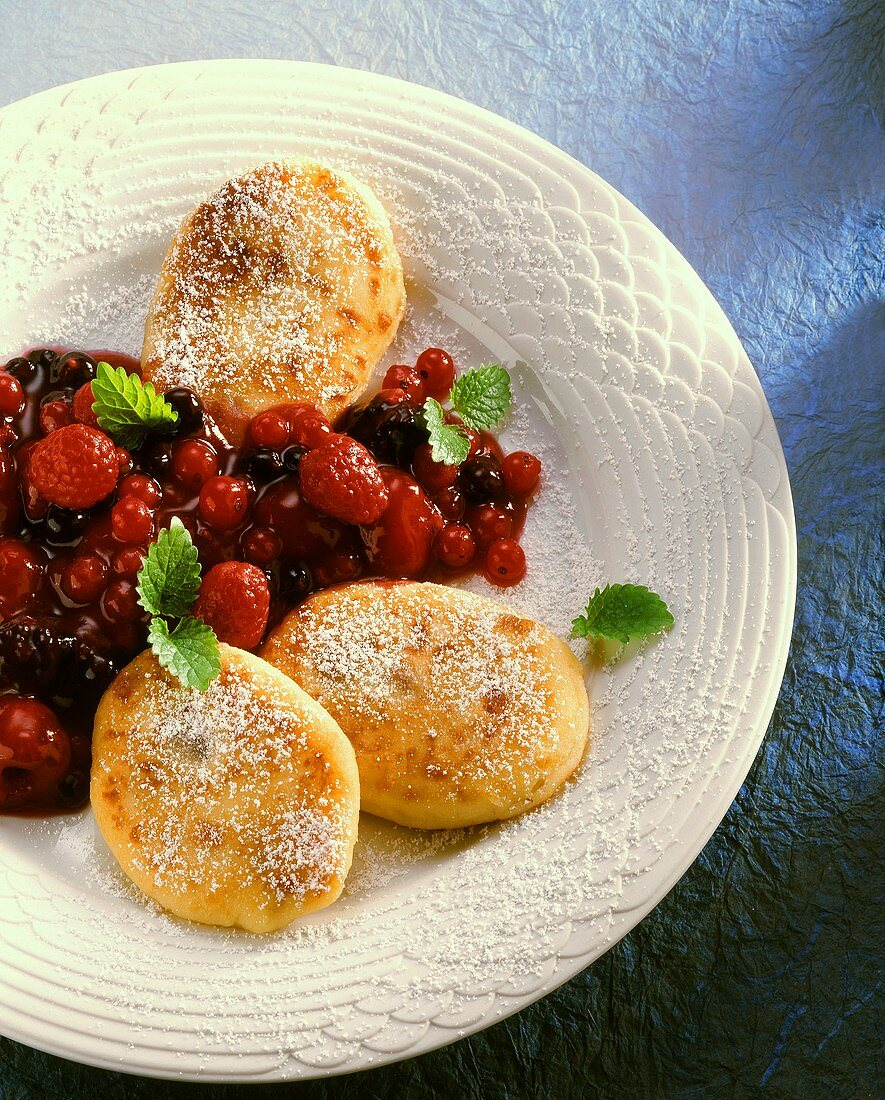 Quark griddle cake with stewed berries on dessert plate
