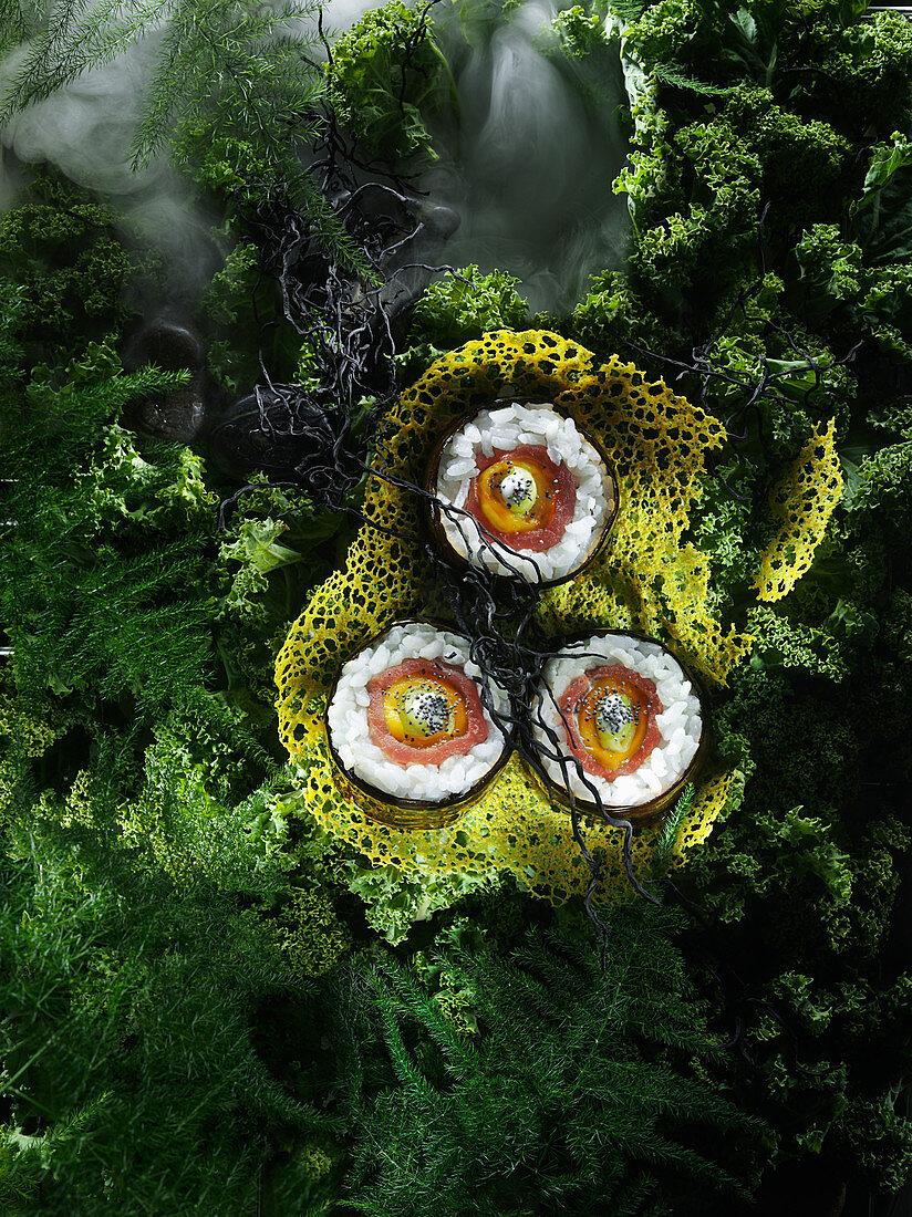 Tuna and mango sushi on a coral wafer
