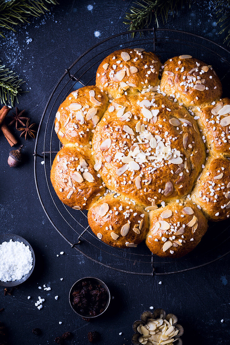 Swiss Three King's cake with sugar nibs and flaked almonds