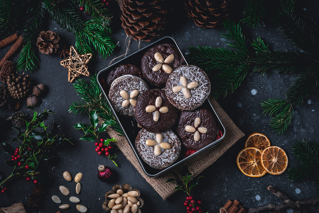 Iced and chocolate Elisenlebkuchen (Nuremberg gingerbread cake) in a tin