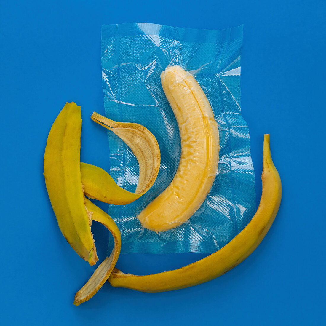 A peeled banana vacuum-packed in a plastic bag