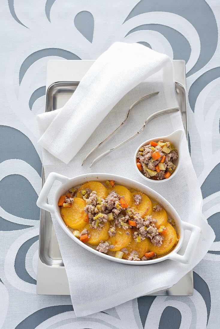 Gratinated polenta gnocchi with a salsiccia and vegetable ragout