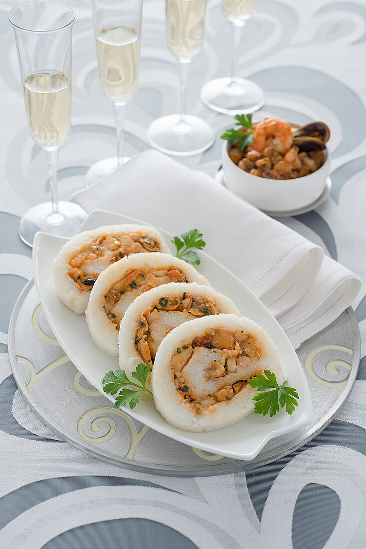 A white polenta roll filled with seafood