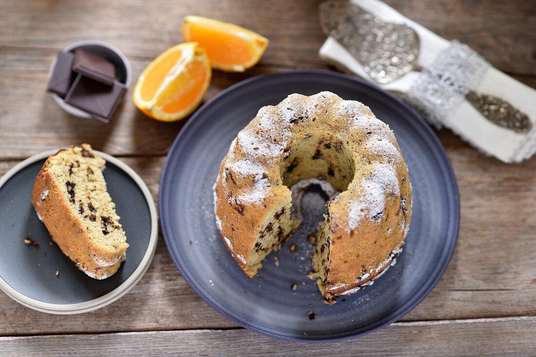 Vegan chocolate-orange Bundt cake with icing sugar, sliced