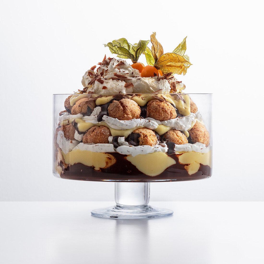 Trifle with soft amaretti, chocolate sauce, custard and cream