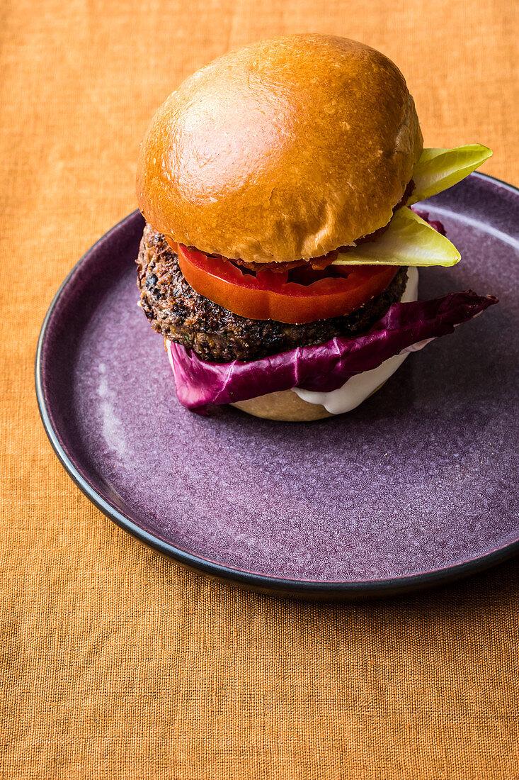 A vegetarian bean burger with aquafaba mayonnaise