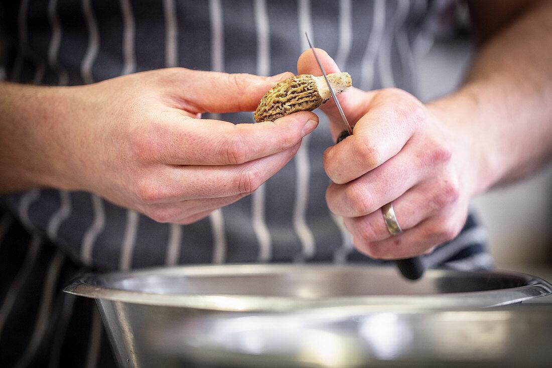 A morel mushroom being prepared