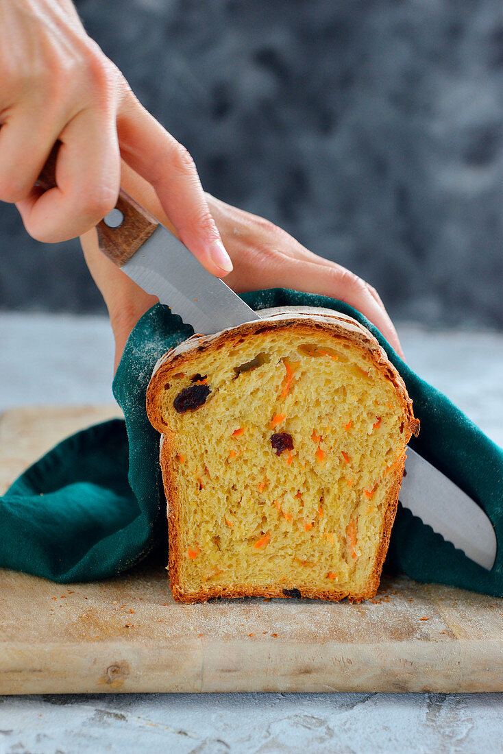 Cutting carrot loaf with cranberries