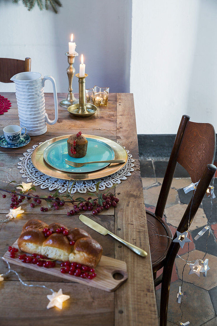 Cakes on rustic, festively set wooden table