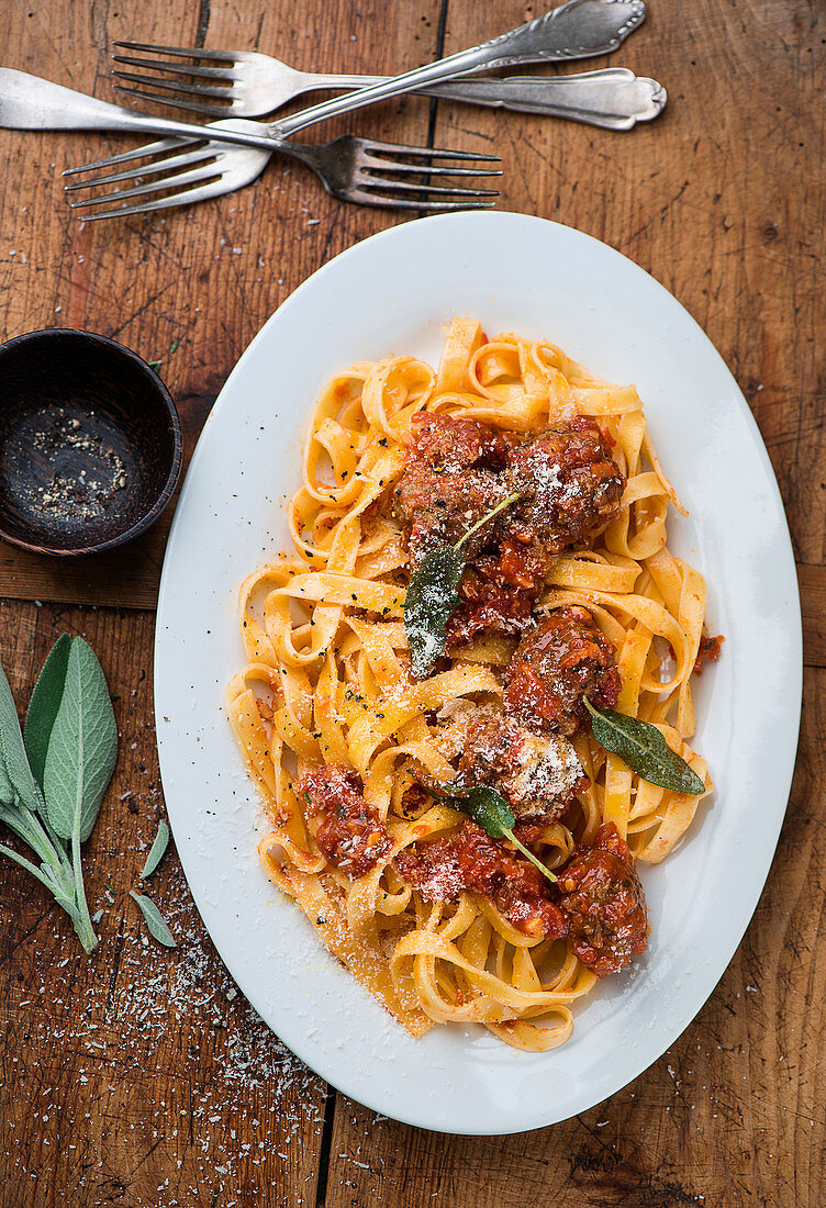 Ribbon pasta with pumpkin meatballs and sage