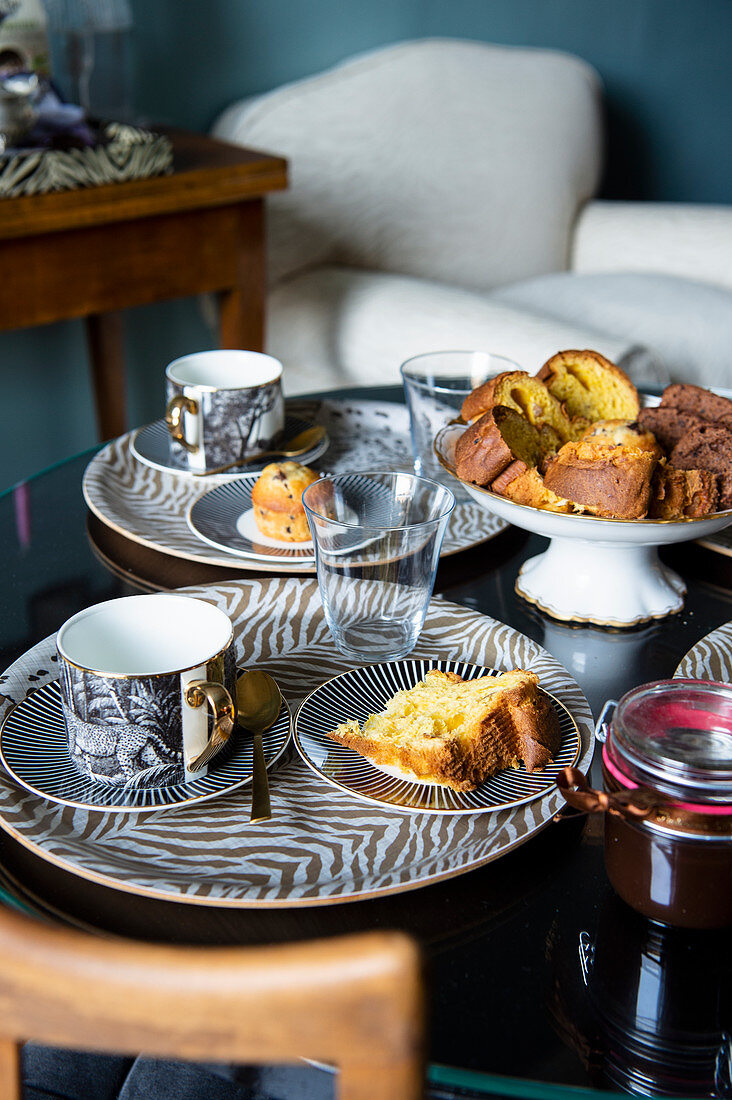 Cakes and pastries served on an elegant animal print crockery