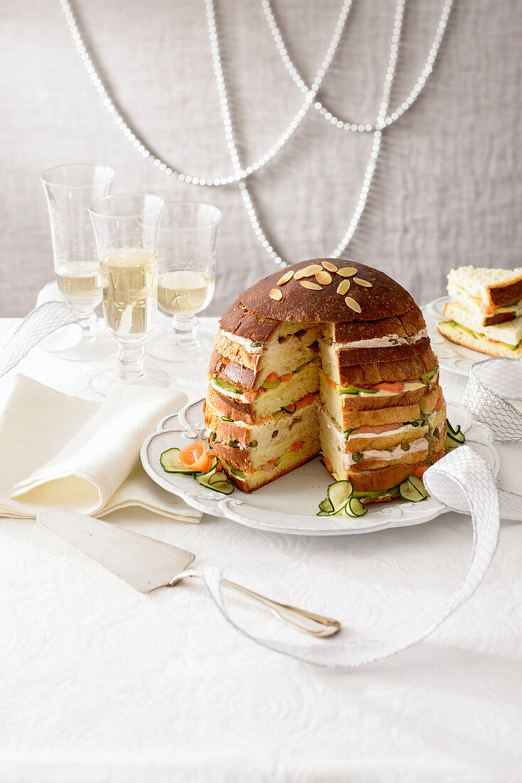 A sandwich cake with salmon and tuna cream