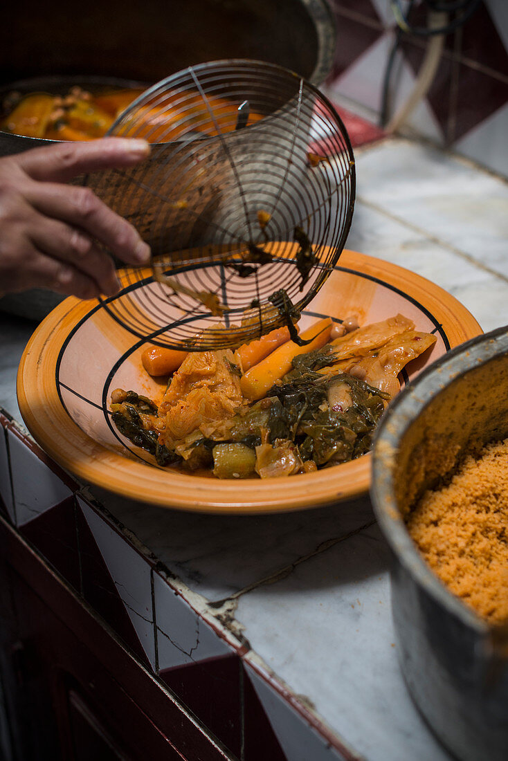 Tunisian couscous with vegetables on a clay plate