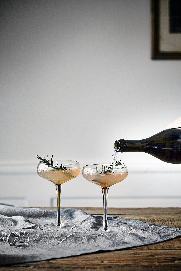Apple champagne cocktail with rosemary