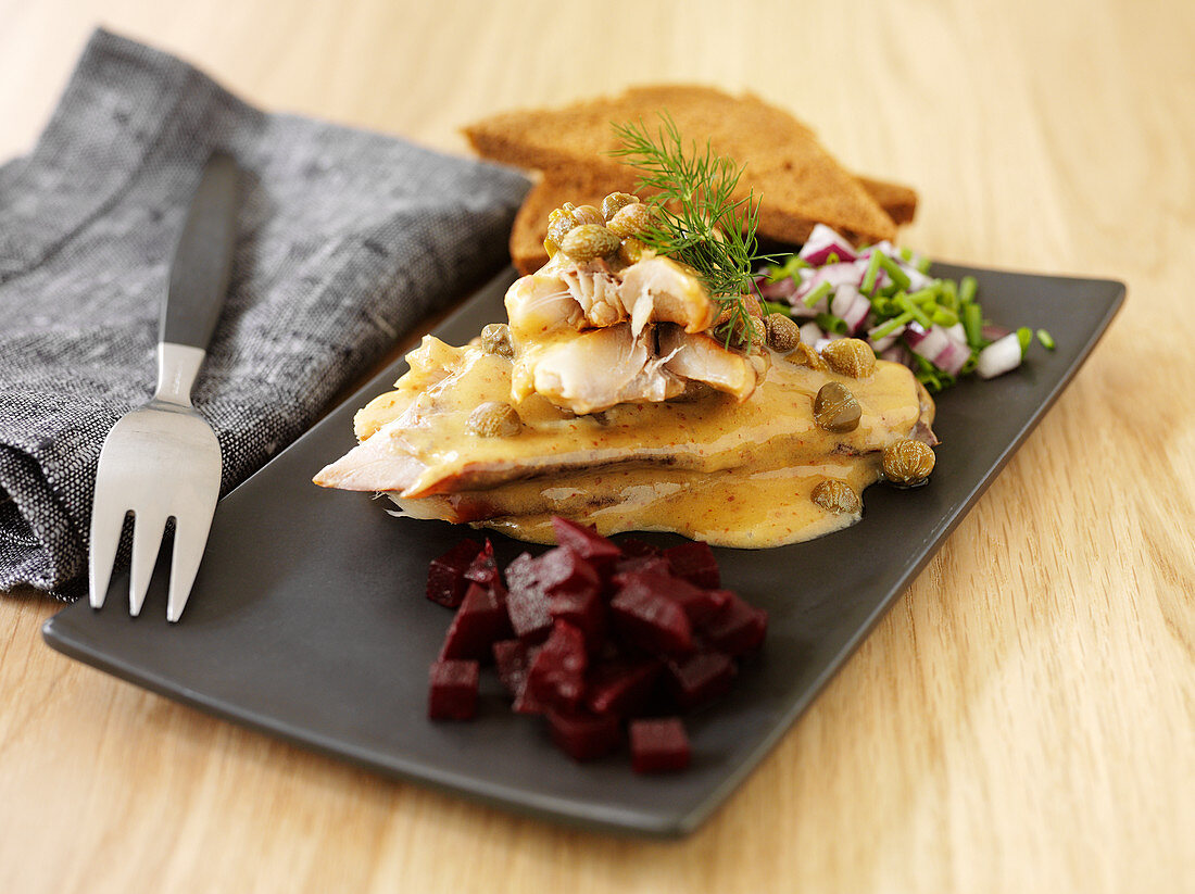 Fish with caper sauce and beetroot