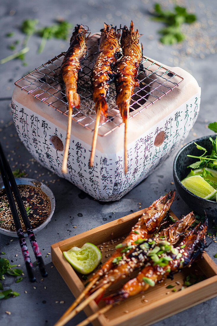 Shrimp skewers with sesame seeds and chili sauce
