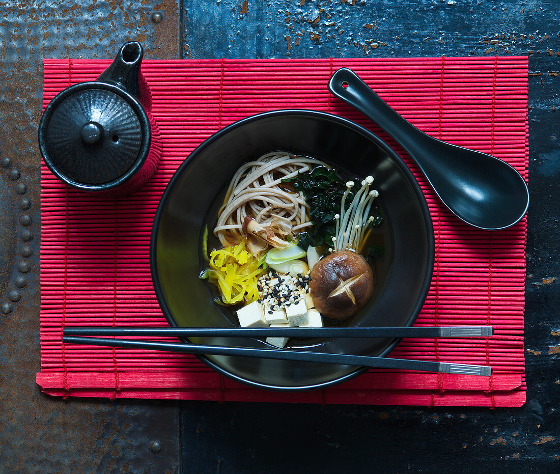 Miso soup with soba noodles and enoki mushrooms