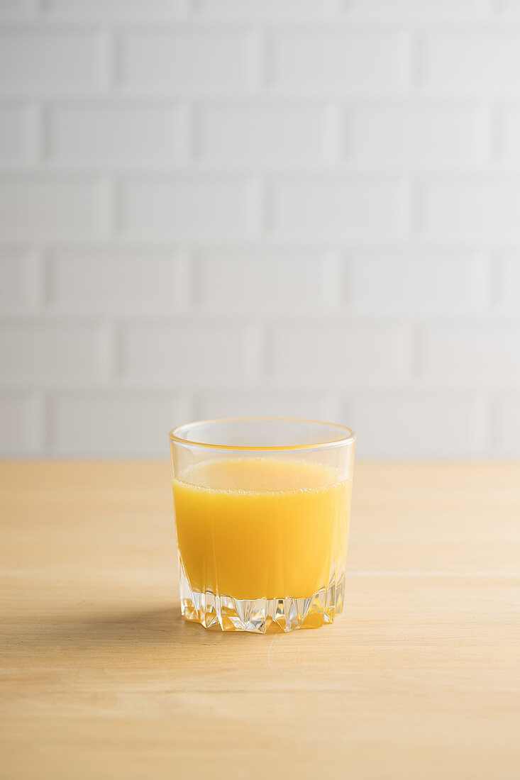 Orange juice in glass on the table