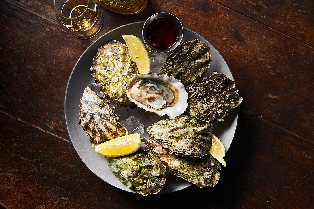 Fresh oysters with lemons in restaurant