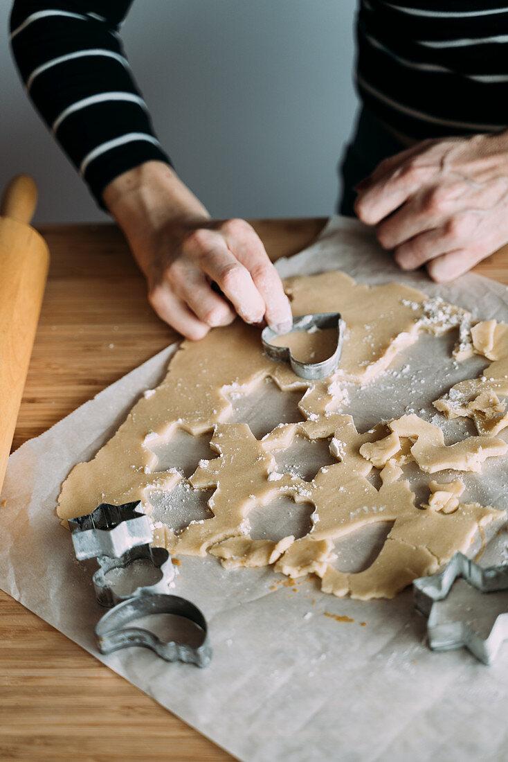 Female chef preparing cookies in kitchen