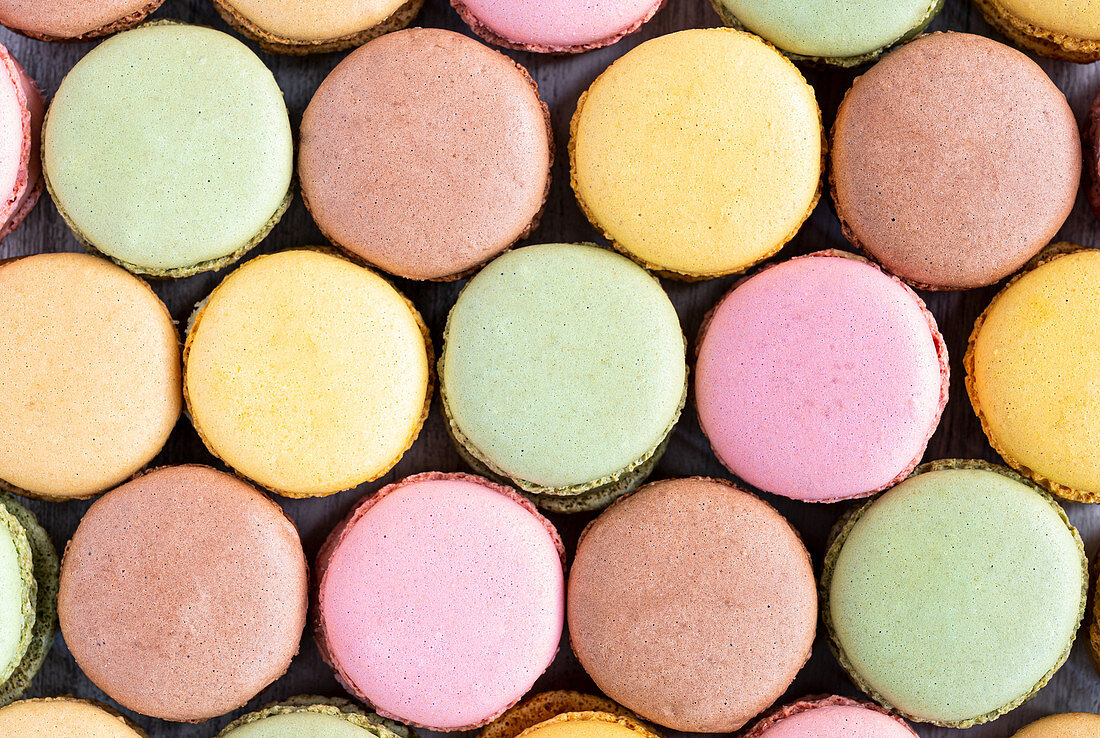 Colorful macaroons displayed in wooden surface