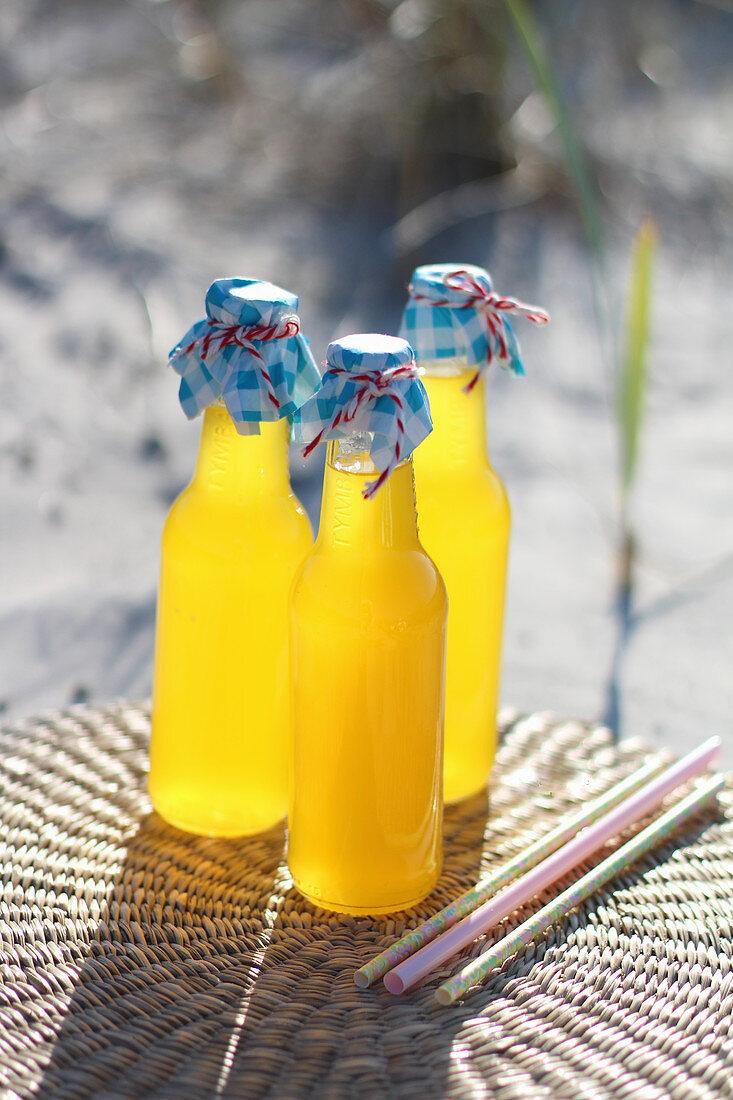 Summery orange lemonade on a garden table