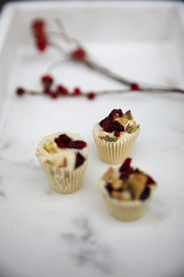 White chocolate confectionery with dried cranberries and pistachios