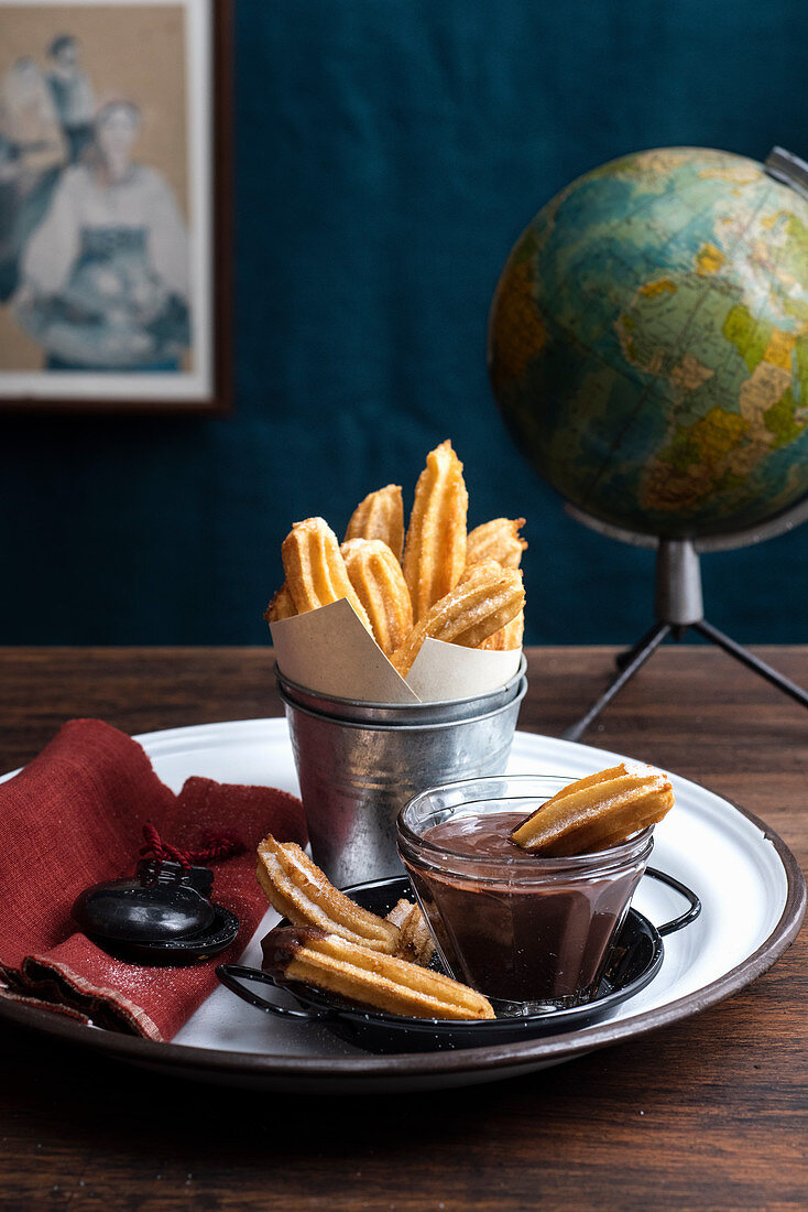Churros (sweet choux pastry sticks with a chocolate dip, Spain)