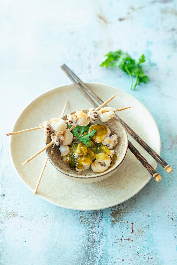 Grilled baby octopus skewers with Thai chili and tamarind sauce