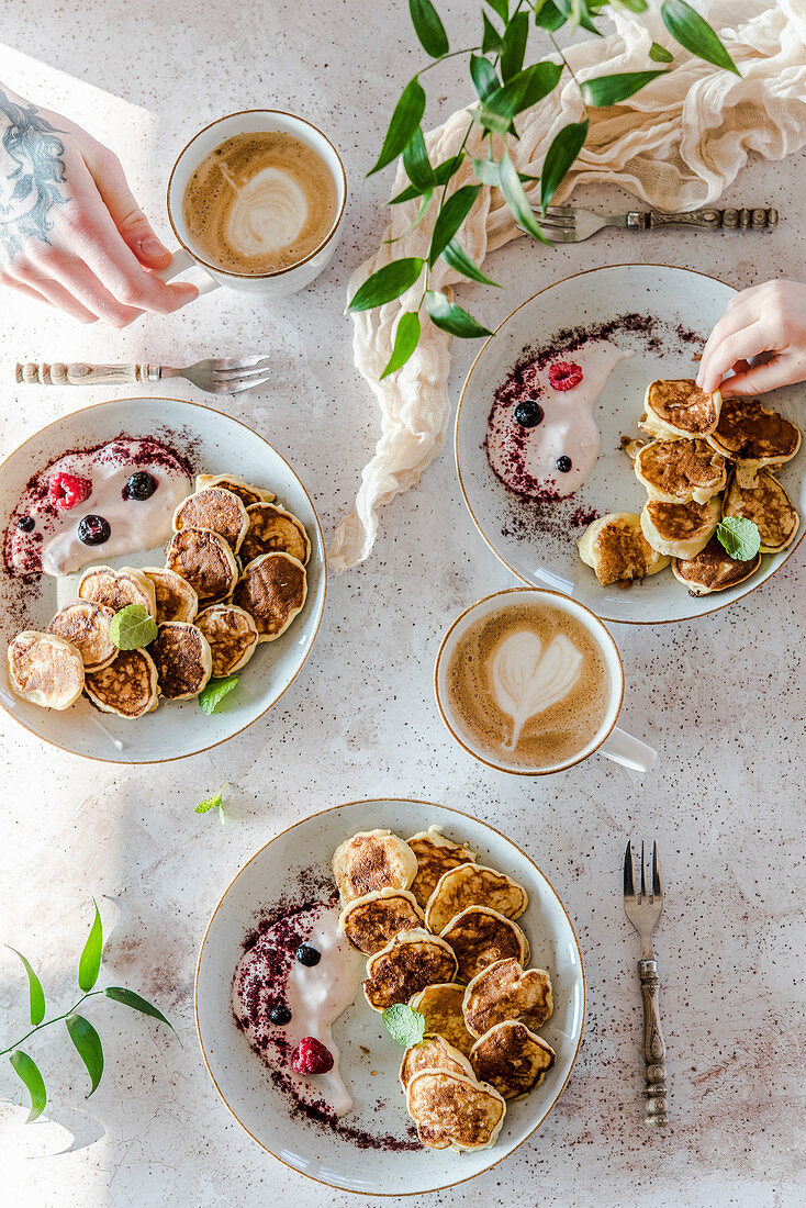 Family breakfast with pancakes and coffee