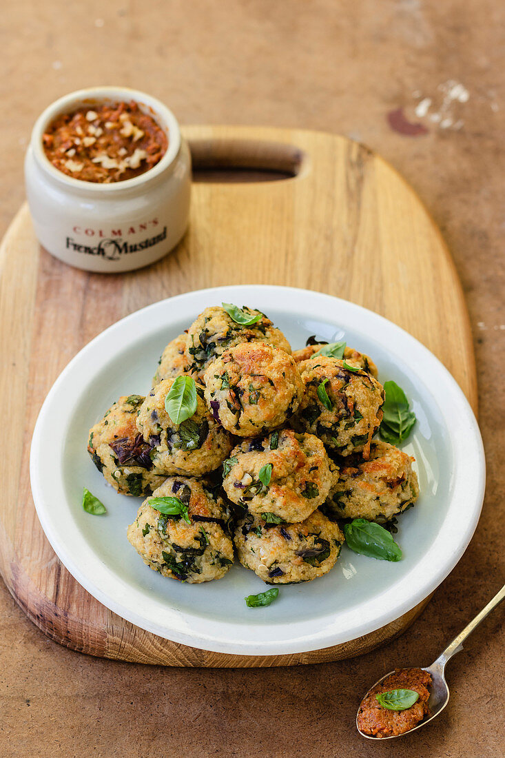 Halloumi and millet vegetarian meatballs, keftedes, red pepper and walnut dip