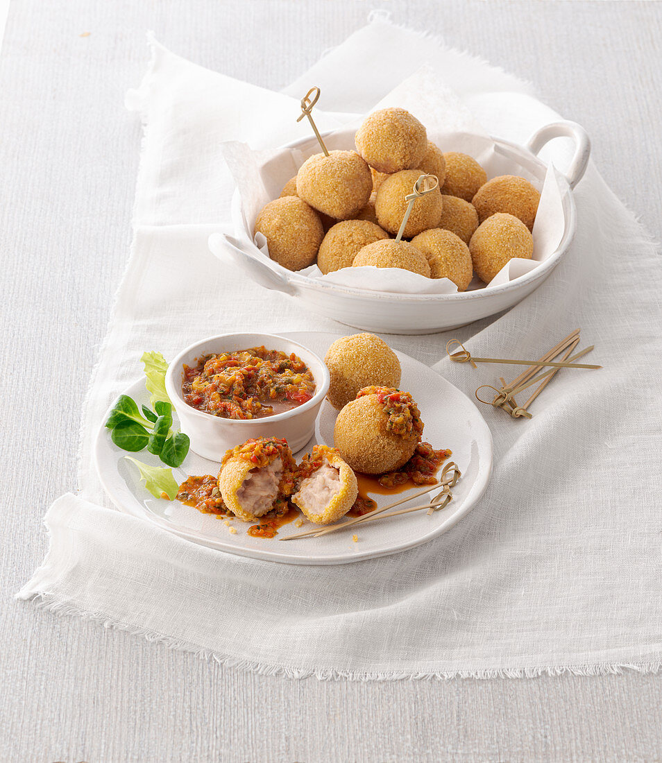 Deep-fried, Spanish-style ham and cheese balls with a paprika sauce