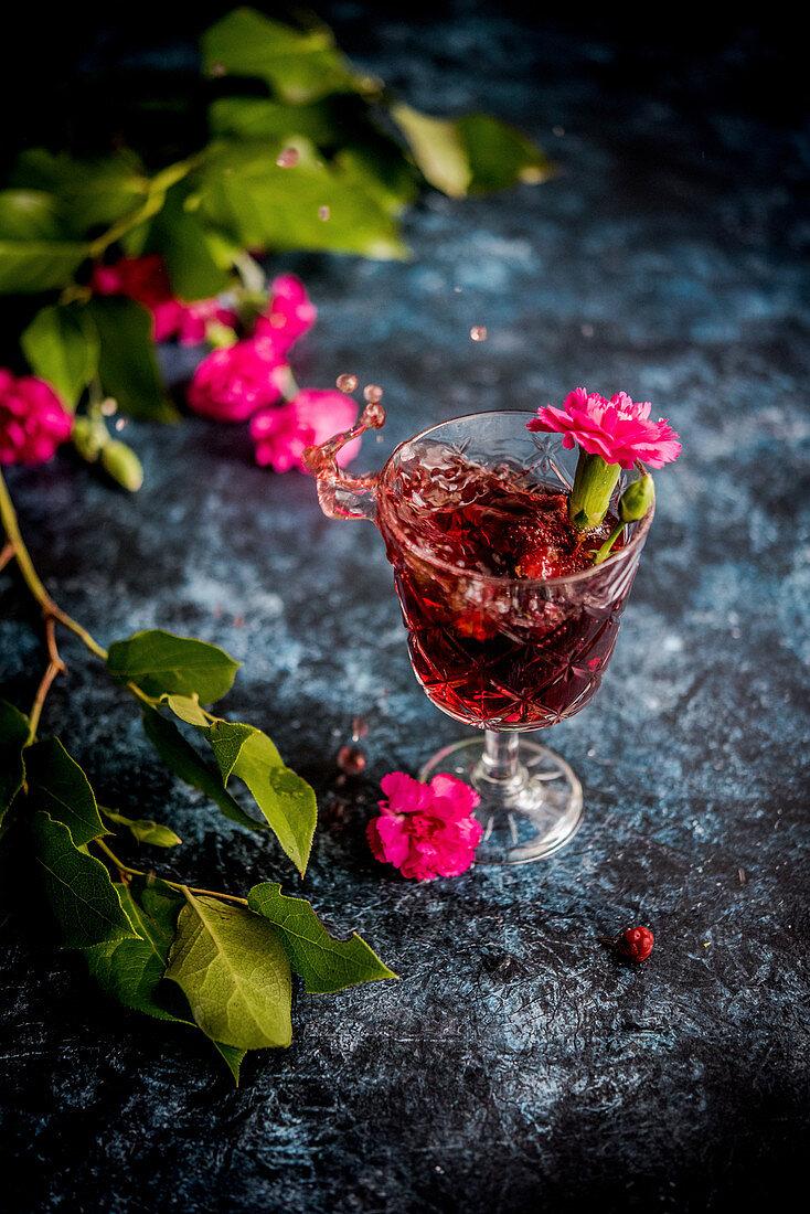 Splashing glass of red wine