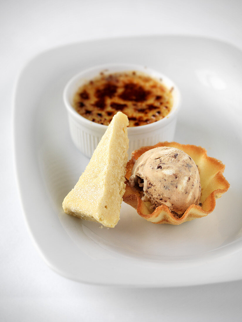 Dessert variations with creme brulee, parfait and ice cream in a biscuit bowl