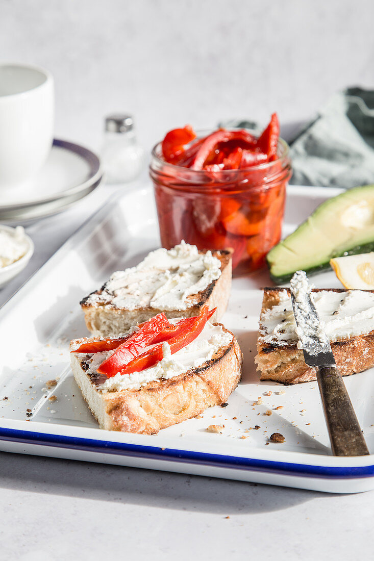 Toasted bread with cream cheese and roasted peppers for breakfast