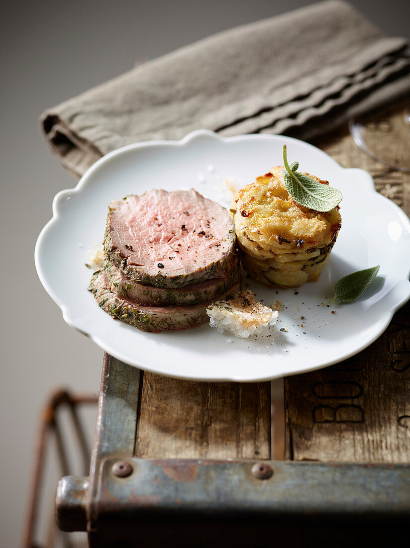 Roast beef in a herb salt crust with Jerusalem artichoke gratin